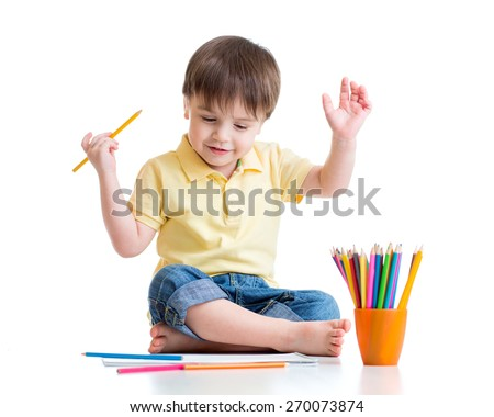 Happy child drawing with pencils in album, isolated on white - stock photo
