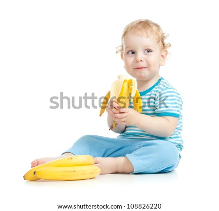 happy child eating healthy food fruits isolated on white - stock photo