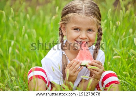 Happy child eating watermelon - stock photo