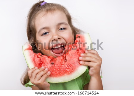 Happy child eating watermelon