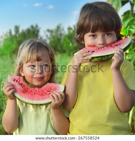 happy child eating watermelon in the garden - stock photo