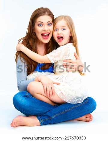Happy Child embrace her mother. Isolated family portrait. - stock photo