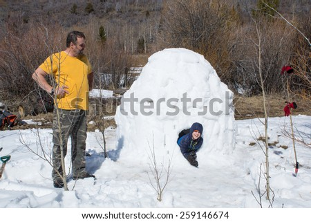 Happy child gets out of the Eskimo home - igloo - stock photo