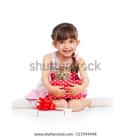 happy child girl holding gift box with kitten - stock photo