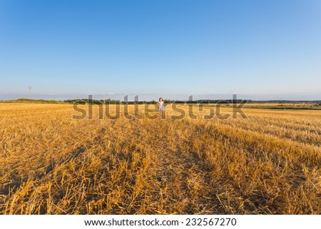 Happy child girl in wheat field. Outdoor. - stock photo