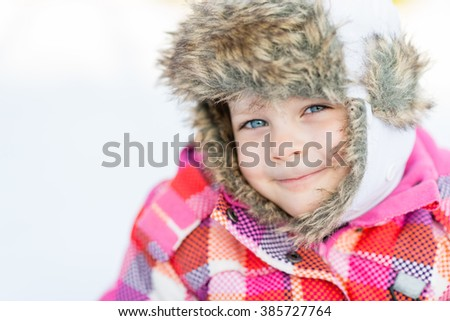 Happy child girl playing on a winter walk in nature - Winter fun - stock photo