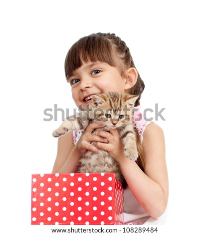 happy child girl takes cat  out gift box - stock photo