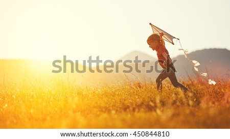 happy child girl with a kite running on meadow in summer in nature - stock photo