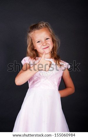 happy child girl with hands thumbs up - stock photo