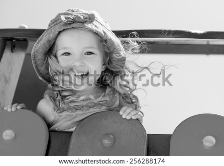 happy child having fun on the playground ( black and white ) - stock photo