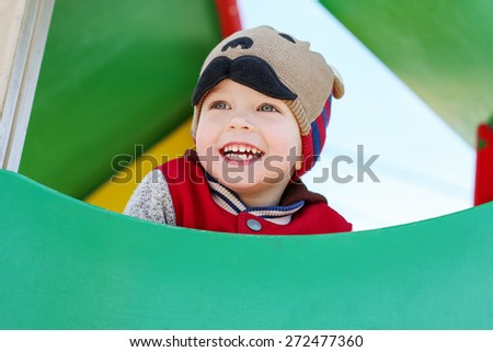happy child having fun on the playground in sunny weather - stock photo