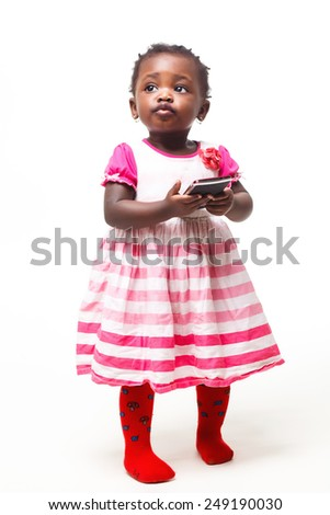 Happy child  holding a mobile phone isolated over white - stock photo