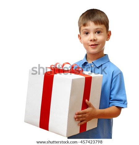 Happy child holding big gift box isolated on white background
