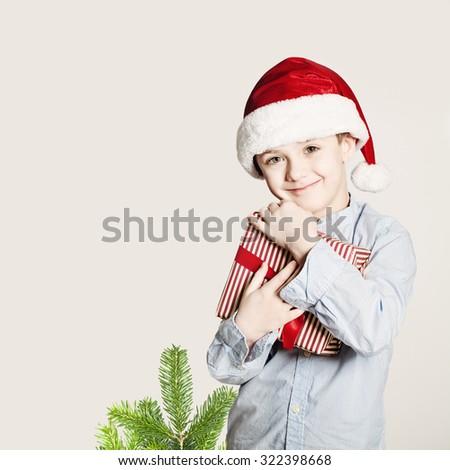 Happy Child Hug Christmas Gift Box. Xmas Happiness Concept - stock photo