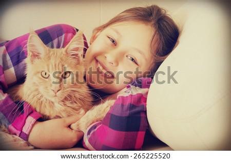 happy child hugging cat - stock photo