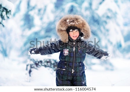 happy child in a beautiful snowy forest - stock photo