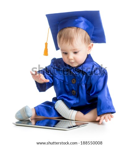 happy child in academician clothes  with laptop - stock photo