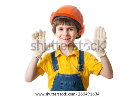 Happy child in building helmet with open palms on white background