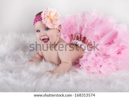 Happy child in lush pink skirt - stock photo