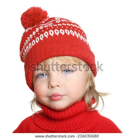 Happy child in red hat and sweater isolated on white background - stock photo