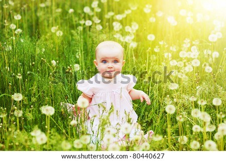 happy child in the field of dandelions - stock photo
