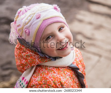 Happy child in warm clothes. - stock photo