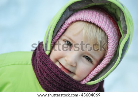 Happy child  in winter parka