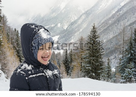 Happy child in wintertime in mountain resort