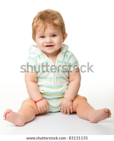 Happy child is sitting on floor, isolated over white - stock photo