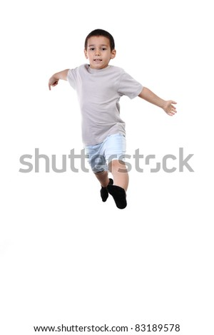 Happy child jumping in mid air isolated on white background