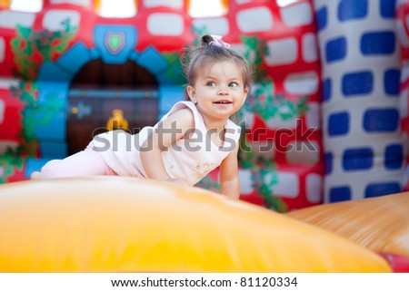 Happy child jumping on trampoline outdoors - stock photo