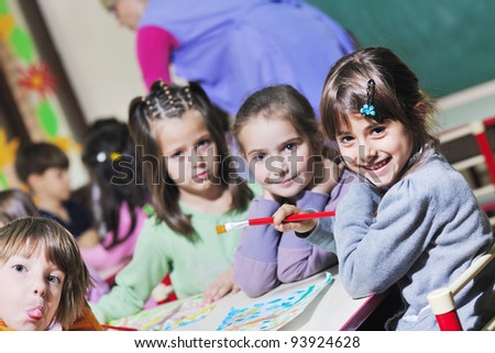 happy child kids group have fun and play at kindergarden indoor preschool education concept with  teacher - stock photo