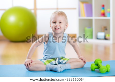happy child little boy goes in for sports