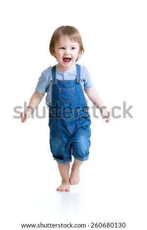 Happy child little boy running isolated over a white - stock photo