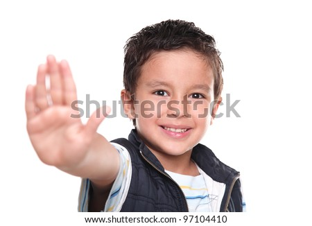 Happy child making a stop signal with hand - stock photo