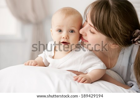 Happy child near to mum in her room - stock photo
