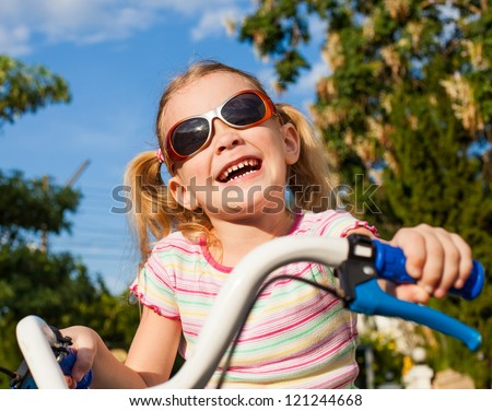 happy child on a bicycle - stock photo