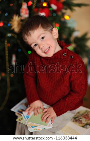 Happy child on Christmas. Portrait of a handsome boy on a background of the holiday - stock photo