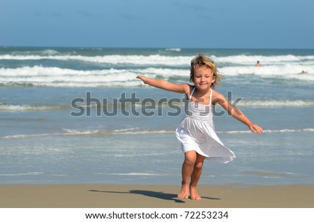 happy child on the beach - stock photo