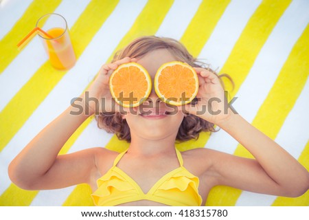 Happy child on the beach. Kid having fun outdoors. Summer vacation concept. Top view portrait - stock photo