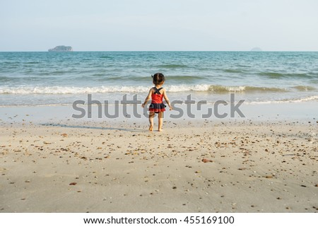 Happy child on the coast of tropical sea - stock photo