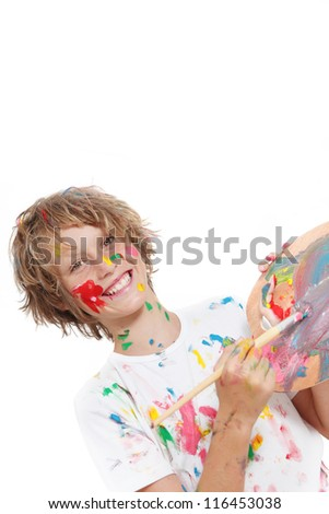 happy child or kid painting with paint and brush - stock photo