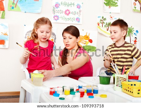 Happy child painting  in school. Education. - stock photo