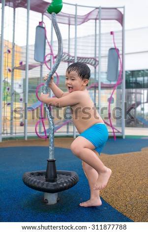 happy child playing at a playground - stock photo