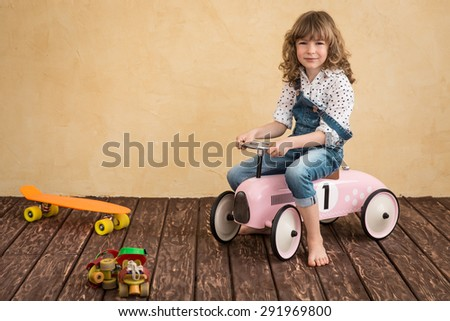 Happy child playing at home. Car trip. Summer vacation and travel concept - stock photo