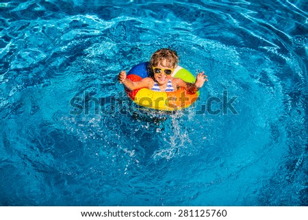 Happy child playing in swimming pool. Summer vacation concept. Top view portrait - stock photo