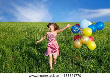 happy child playing outdoors - stock photo
