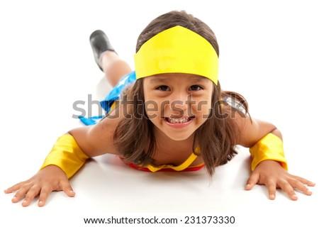 Happy child playing with hero costume . - stock photo