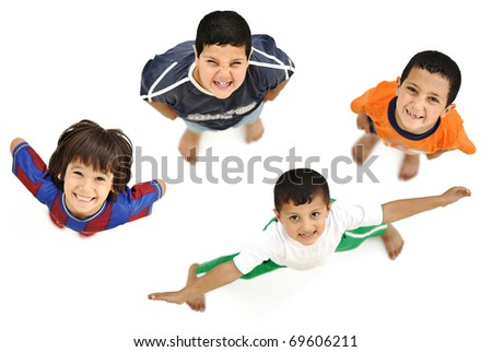 Happy child, positive fresh little smiling boy from above, different angle, isolated on white, full body