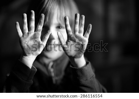 Happy child showing his dirty hands, focus on hands - stock photo